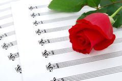Song of love. A rose and music sheets Royalty Free Stock Photography