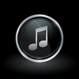 Song note icon inside round silver and black emblem. Song note symbol with key tone icon inside round chrome silver and black button emblem on black background Royalty Free Stock Images