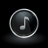 Song note icon inside round silver and black emblem. Song note symbol with key tone icon inside round chrome silver and black button emblem on black background Royalty Free Stock Image