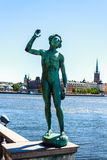 Song statues. With Stockholm Town Hall in the background, Stockholm, Sweden Royalty Free Stock Images
