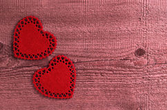Song for Valentine's day. Two red hearts cut from soft tissue lying on old wooden boards Stock Image