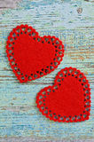 Song for Valentine's day. Two red hearts cut from soft tissue are old painted wooden boards Stock Photos