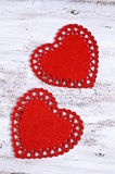 Song for Valentine's day. Two red hearts cut from soft tissue are old painted wooden boards Stock Photo