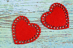 Song for Valentine's day. Two red hearts cut from soft tissue are old painted wooden boards Royalty Free Stock Image