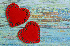 Song for Valentine's day. Two red hearts cut from soft tissue are old painted wooden boards Stock Photography
