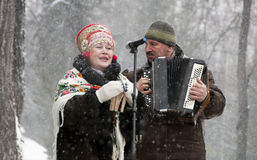 Song will warm. MOSCOW - FEBRUARY 25:  Russian ensemble concert Russian Style for the Celebration of Shrovetide, a traditional Russian holiday (pancake week Royalty Free Stock Photos