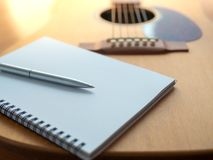 Song Writing. Songwriting Tools, Guitar, Notebook, and Pen on Wooden Background Stock Photography