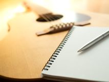 Song Writing. Songwriting Tools, Guitar, Notebook, and Pen on Wooden Background Stock Images
