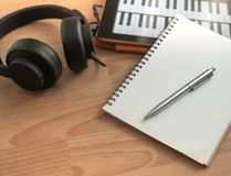 Song Writing. Songwriting Tools, Headphone, Notebook, Electronic Tablet and Pen on Wooden Background Royalty Free Stock Images