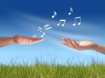 Song for you. Woman's and man's hand. This song for you concept Royalty Free Stock Images