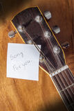 Song for you. Acoustic guitar and message paper Stock Photography