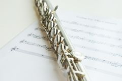 Flute and musical notes, music instrument. stock photo