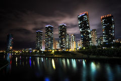 Songdo Canal night reflection. S taken right before the summer storm. Hotels apartments and office buildings reflecting on the small canal. Songdo, Incheon Royalty Free Stock Image