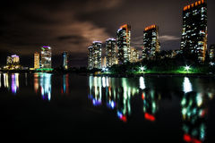 Songdo Canal night reflection. S taken right before the summer storm. Hotels apartments and office buildings reflecting on the small canal. Songdo, Incheon Stock Images