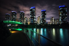 Songdo Canal night reflection. S taken right before the summer storm. Hotels apartments and office buildings reflecting on the small canal. Songdo, Incheon Royalty Free Stock Photo