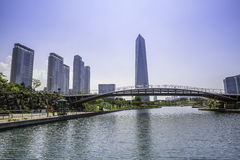 Songdo Central Park, South Korea. Bridge over waters in Songdo Central Park, Incheon, South Korea with modern skyline royalty free stock photography