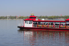 Songhua River Cruise Harbin China. A tourist boat carrying passengers on the Songhua River in Harbin China in Heilongjiang province Stock Photo
