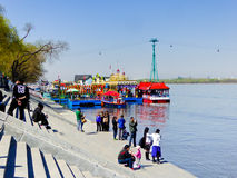 Songhua River south shore Wharf. Tourists sitting on the stairs of Songhuajiang river south shore wharf in Heilongjiang province China royalty free stock images