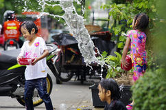 Songkarn Thai new year - water festival. BANGKOK - APRIL 14 2012: Songkran (thai new year / water festival) is celebrated from april 13 to 15. people roam the Royalty Free Stock Images