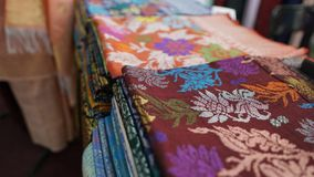 Songket. Is a fabric that belongs to the brocade family of textiles of the Malay world It is hand-woven in silk or cotton, and intricately patterned with gold Royalty Free Stock Photos