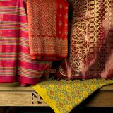 Songket textiles. Songket is a fabric that belongs to the brocade family of textiles of the Malay world today Indonesia, Malaysia, Brunei, Singapore and Southern Royalty Free Stock Photo