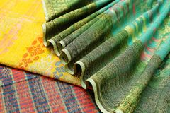 Songket. Is a fabric that belongs to the brocade family of textiles of the Malay world today Indonesia, Malaysia, Brunei, Singapore and Southern Thailand. It is stock images