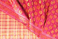Songket. Is a fabric that belongs to the brocade family of textiles of the Malay world today Indonesia, Malaysia, Brunei, Singapore and Southern Thailand. It is royalty free stock images