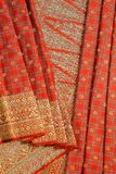 Songket. Is a fabric that belongs to the brocade family of textiles of the Malay world today Indonesia, Malaysia, Brunei, Singapore and Southern Thailand. It is royalty free stock photography