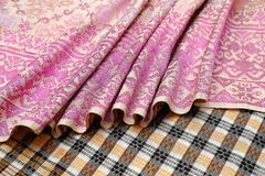 Songket. Is a fabric that belongs to the brocade family of textiles of the Malay world today Indonesia, Malaysia, Brunei, Singapore and Southern Thailand. It is stock photography