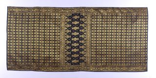 Songket. Is a fabric that belongs to the brocade family of textiles of the Malay world today Indonesia, Malaysia, Brunei, Singapore and Southern Thailand. It is stock image