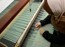 Songket textiles. Songket is a fabric that belongs to the brocade family of textiles of the Malay world today Indonesia, Malaysia, Brunei, Singapore and Southern stock images