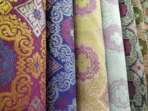 Songket. Is a fabric that belongs to the brocade family of textiles of Indonesia, Malaysia and Brunei. It is hand-woven in silk or cotton, and intricately stock photo