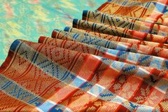 Songket. Is a fabric that belongs to the brocade family of textiles of the Malay world today Indonesia, Malaysia, Brunei, Singapore and Southern Thailand. It is stock photo