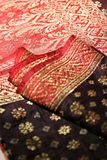 Songket. Is a fabric that belongs to the brocade family of textiles of the Malay world today Indonesia, Malaysia, Brunei, Singapore and Southern Thailand. It is stock photos