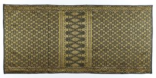 Songket. Is a fabric that belongs to the brocade family of textiles of the Malay world today Indonesia, Malaysia, Brunei, Singapore and Southern Thailand. It is royalty free stock photos