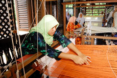 Songket Weaving. Songket is a fabric that belongs to the brocade family of textiles of Indonesia, Malaysia, and Brunei. It is hand-woven in silk or cotton, and Royalty Free Stock Photos