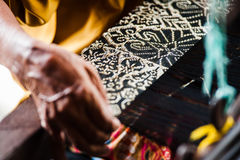 Songket Weaving. View of songket weaving done with traditional method Royalty Free Stock Photography