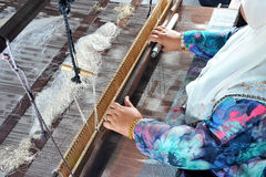 Songket Weaving. Songket, aptly dubbed Malaysia's Cloth of Gold, is a proud legacy of the courts of Kelantan and Pattani. Richly woven with gold or silver thread Royalty Free Stock Image
