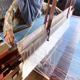 Songket Weaving, Terengganu, Malaysia. Songket is a magnificent piece of traditional Malay fabric handwoven in silk or cotton threads, using colourful metallic Stock Images