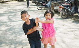 Songkhla, Thailand - April 8, 2017 : Boy and girl having fun together at Wat Kongkawadee in Songkhla Thailand. Songkhla, Thailand - April 8, 2017 : Boy and girl Stock Images