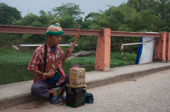 SONGKHLA, THAILAND - AUGUST 11 :. Unidentified male thai traditional musician play music for money donation for his child on Aug 11, 2012 at Songkhla Klonghae royalty free stock image