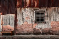 Free Songkhla, THAILAND - Old Grunge Timeworn Building Brick Wall And Window At Songkhla Nang Ngam Street Famous Historic Stock Photography - 131671022