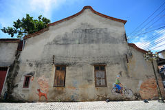SONGKHLA, THAILAND - SEPTEMBER 19, 2016: Street art on Old building. SONGKHLA, THAILAND - SEPTEMBER 19, 2016: Street art on Old buildind at Old Town in Songkhla Royalty Free Stock Photo