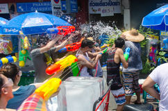 Songkran ambush. Bangkok, Thailand, 14 April 2015. Festival goers at Khao San Road spraying each other with water guns during the annual Songkran water festival Stock Images