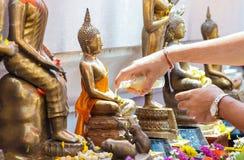 Songkran buddha. Soaking buddha in Songkran festival Thailand Royalty Free Stock Photos