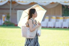 A women dress traditional clothes during Songkran. Songkran is celebration of the Thai New Year which is every 13 April. However, the Thai government extends the Stock Photos