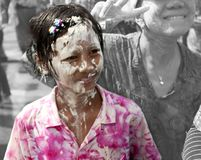 Songkran in Chiang Mai, Thailand. On the 13th of April 2013.nSmiling girl with wet paste on her face Royalty Free Stock Photo