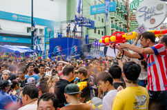 Songkran crowd. Bangkok, Thailand, 13 April 2015. Festival goers at Khao San Road spraying each other with water guns during the annual Songkran water festival Stock Photo