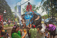 Songkran festival. Celebration of thai new year, elephant pours water to the people on the street  - Songkran, Ayuttaya, Thailand Royalty Free Stock Photos