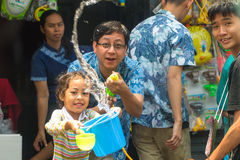 Songkran festival on April 13, 2015. CHIANG MAI, THAILAND - APRIL 13 : Father and daughter enjoy splashing water together in songkran festival on April 13, 2015 Royalty Free Stock Photo